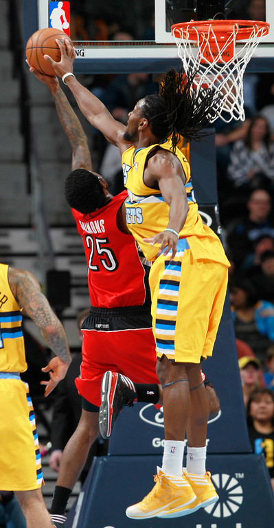 . Denver Nuggets forward Kenneth Faried, right, blocks shot by Toronto Raptors forward John Salmons in the fourth quarter of the Raptors\' 100-90 victory in an NBA basketball game in Denver on Friday, Jan. 31, 2014. (AP Photo/David Zalubowski)