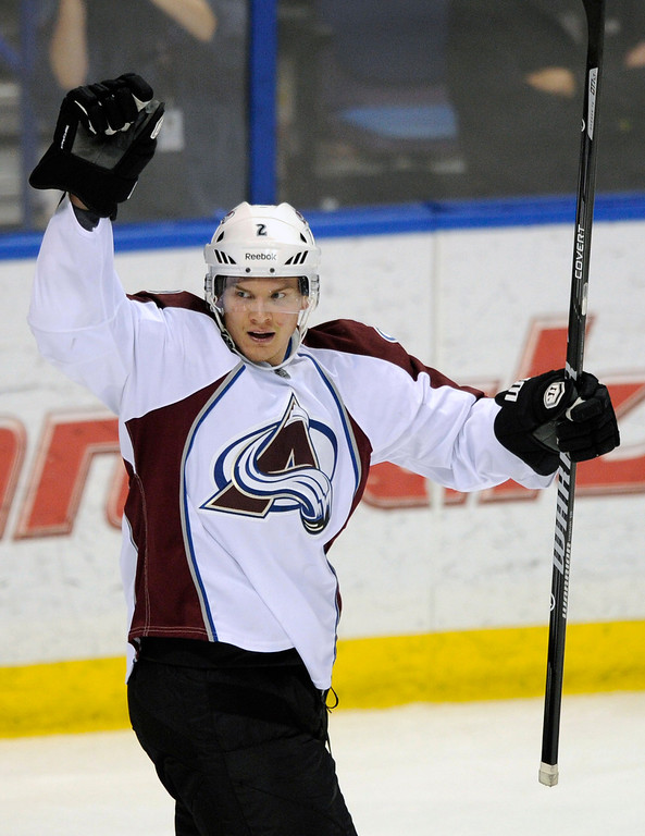 . Colorado Avalanche\'s Nick Holden celebrates a goal against the St. Louis Blues during the second period of an NHL hockey game on Saturday, April 5, 2014, in St. Louis. (AP Photo/Bill Boyce)