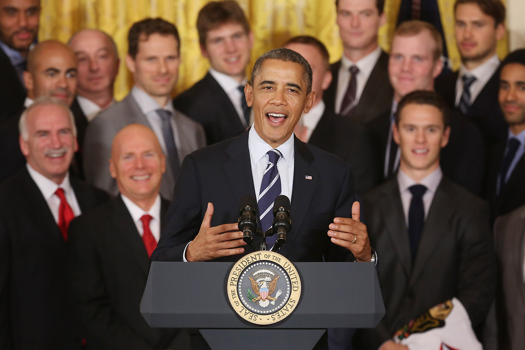 . U.S. President Barack Obama delivers remarks while welcoming the 2013 National Hockey League champion Chicago Blackhawks in the East Room of the White House November 4, 2013 in Washington, DC.  (Photo by Chip Somodevilla/Getty Images)