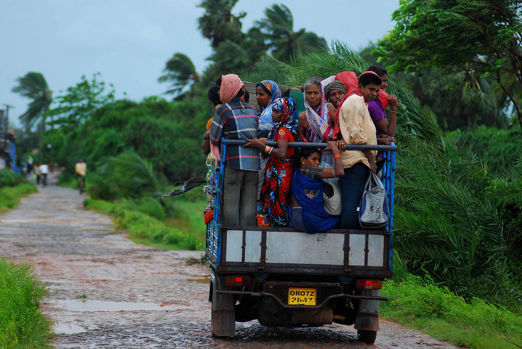 . Indian evacuees travel in an auto rickshaw as they leave their village towards a safe place through heavy wind and rain in Sanabandha Village near Gopalpur, about 195 south from eastern city Bhubaneswar on October 12, 2013.   Nearly half a million people have been evacuated from India\'s impoverished east coast ahead of a massive cyclone expected to make landfall on October 12 evening, disaster officials said. ASIT KUMAR/AFP/Getty Images