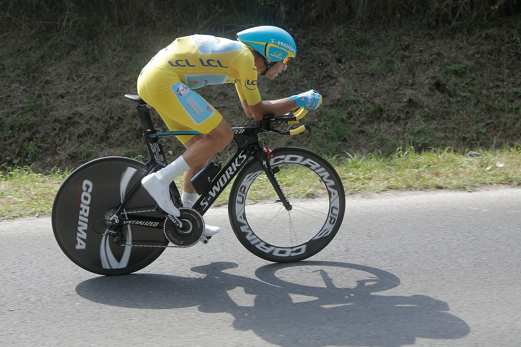 . Italy\'s Vincenzo Nibali, wearing the overall leader\'s yellow jersey, rides during the twentieth stage of the Tour de France cycling race, an individual time-trial over 54 kilometers (33.6 miles) with start in Bergerac and finish in Perigueux, France, Saturday, July 26, 2014. (AP Photo/Laurent Cipriani)