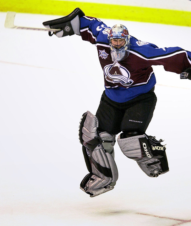 . Colorado goalie Patrick Roy, #33, celebrates the Avalanche\'s overtime victory over the Washington Capitals 4-3, Tuesday night at the MCI Center. The win made Roy the winningest goalie in NHL history. (Mark Reis/The Gazette)