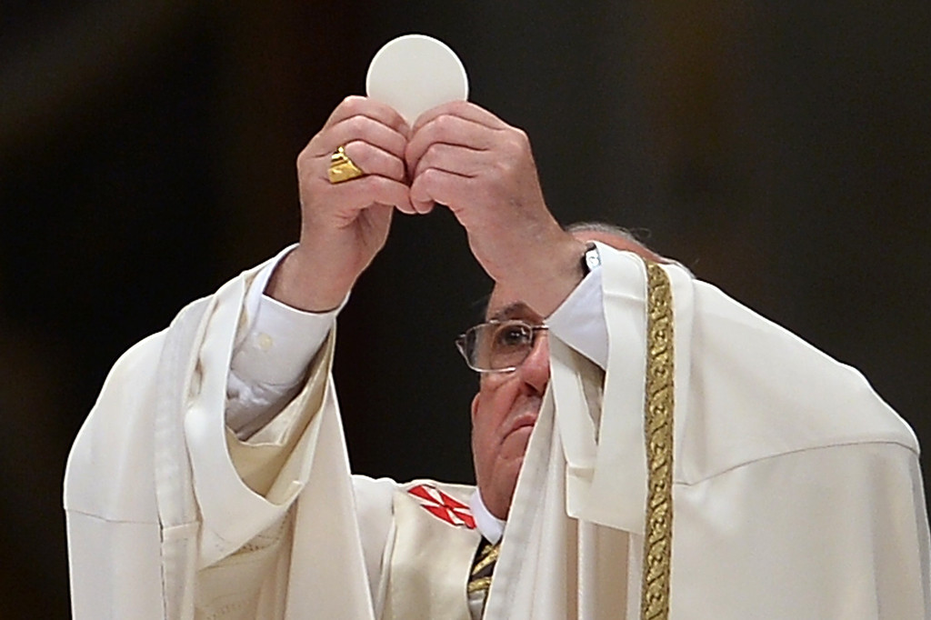 . Pope Francis celebrates the Eucharist during the Easter Vigil at the St Peter basilica in Vatican. Easter Vigil, also called the Paschal Vigil is a service held in traditional Christian churches as the first official celebration of the Resurrection of Jesus.  AFP PHOTO / FILIPPO  MONTEFORTE/AFP/Getty Images