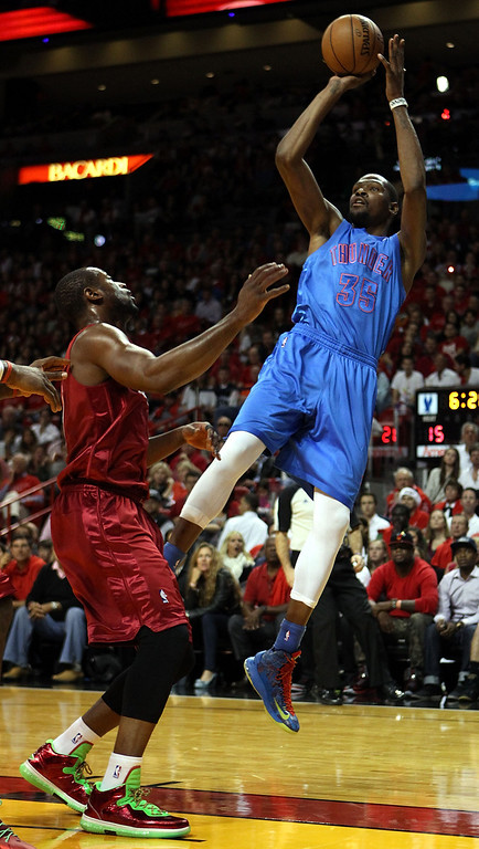 . MIAMI, FL - DECEMBER 25: Forward Kevin Durant #35 of the Oklahoma City Thunder shoots against Dwyane Wade #3 of the Miami Heat at AmericanAirlines Arena on December 25, 2012 in Miami, Florida.  (Photo by Marc Serota/Getty Images)