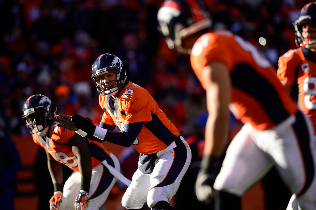. Denver Broncos quarterback Peyton Manning (18) talks to his offense in the first quarter. The Denver Broncos take on the San Diego Chargers at Sports Authority Field at Mile High in Denver on January 12, 2014. (Photo by AAron Ontiveroz/The Denver Post)
