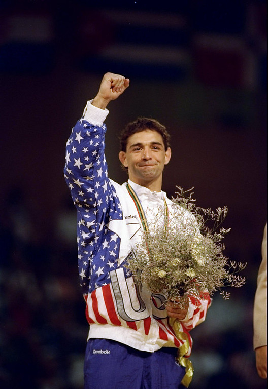 . John Smith of the United States raises his fist in victory after winning a gold medal during the Summer Olympics in Barcelona, Spain. (Shaun Botterill/The Denver Post)
