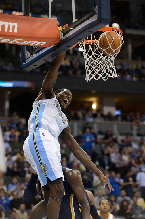 . DENVER, CO. - JANUARY 28: Denver Nuggets small forward Kenneth Faried (35) slams on through during the third quarter January 28, 2013 at Pepsi Center. The Denver Nuggets defeated  the Indiana Pacers 102-101 in NBA Action. (Photo By John Leyba / The Denver Post)