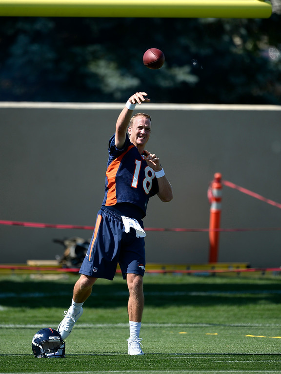. Denver Broncos quarterback Peyton Manning (18) warms up as he throws on day two of the Denver Broncos 2014 training camp July 25, 2014 at Dove Valley. (Photo by John Leyba/The Denver Post)
