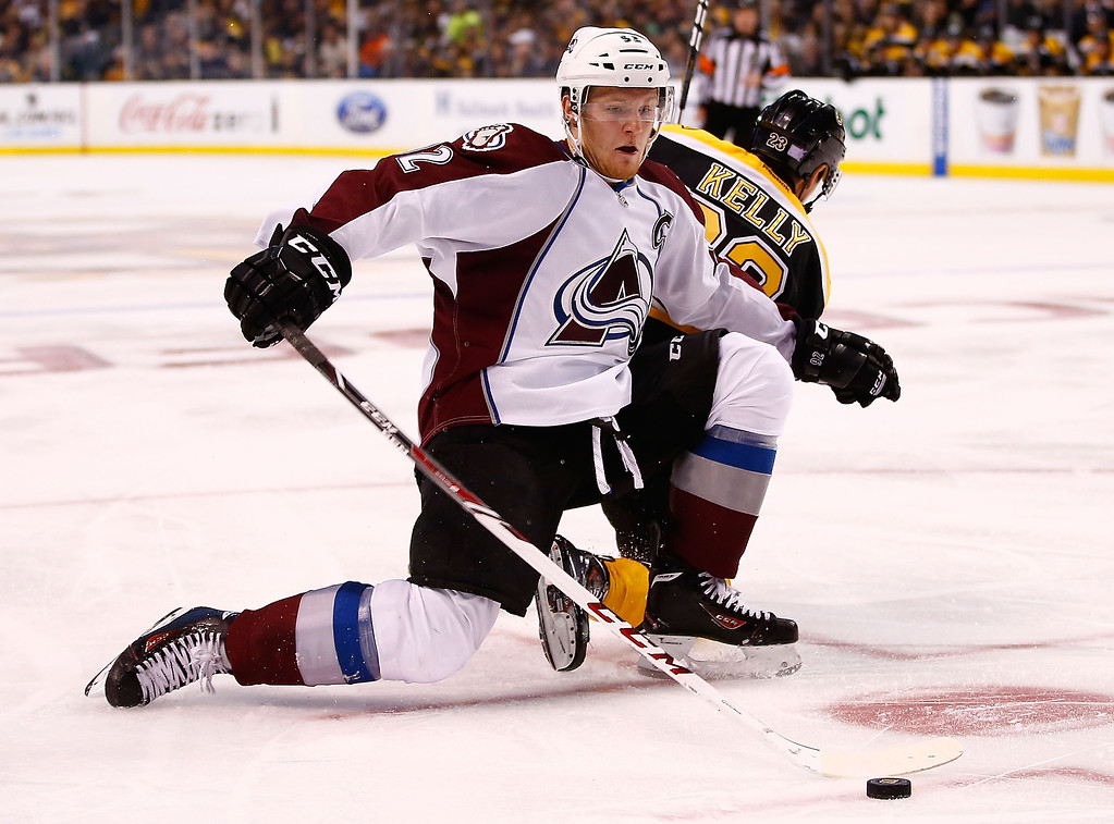 . Gabriel Landeskog #92 of the Colorado Avalanche and Chris Kelly #23 of the Boston Bruins battle for the puck in the second period during the game on October 10, 2013 at TD Garden in Boston, Massachusetts. (Photo by Jared Wickerham/Getty Images)