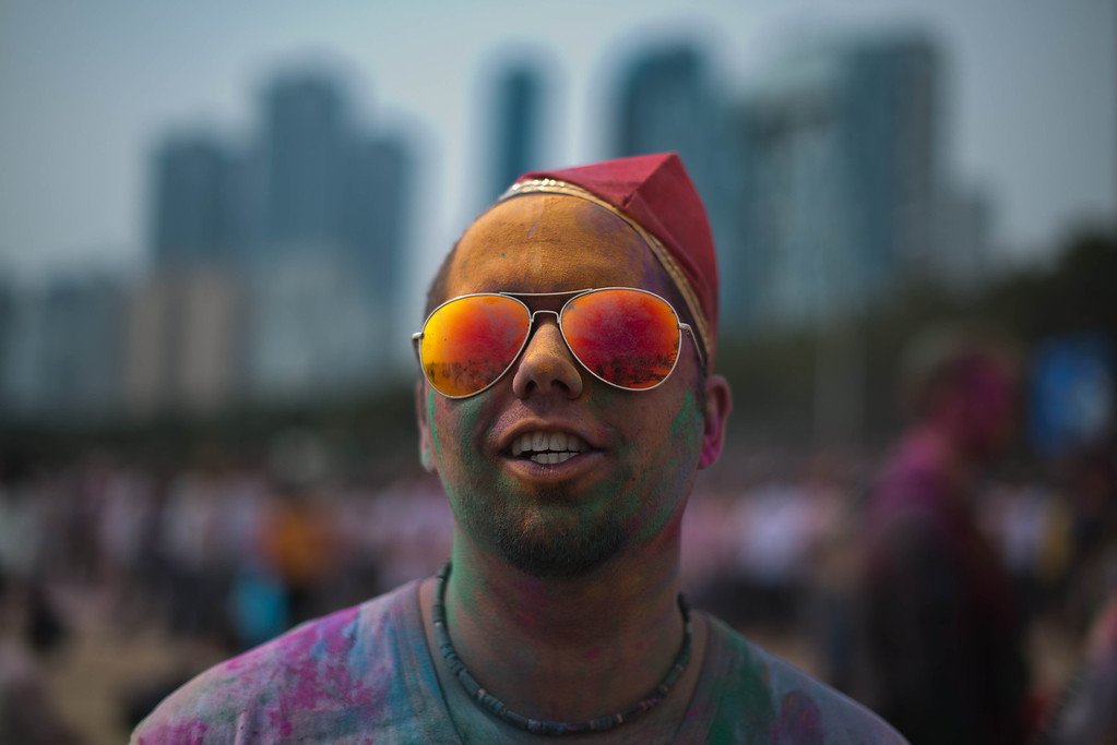 . A man takes part in Holi celebrations organised by members of South Korea\'s Indian community at Haeundae beach in the southeastern city of Busan on March 16, 2014.   AFP PHOTO / Ed JonesED JONES/AFP/Getty Images