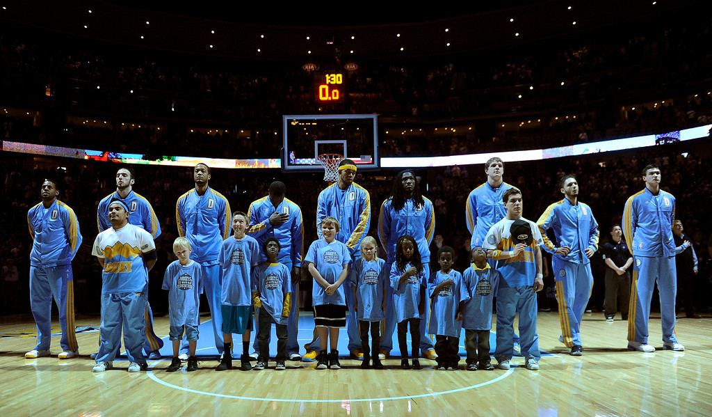 . DENVER, CO. - MARCH 21: The Denver Nuggets lined up for the National Anthem Thursday night. The Denver Nuggets hosted the Philadelphia 76ers Thursday night, March 21, 2013 at the Pepsi Center. (Photo By Karl Gehring/The Denver Post)