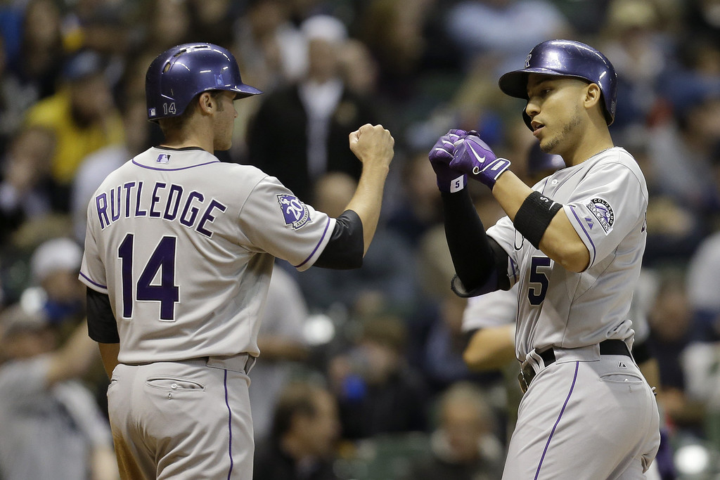 . MILWAUKEE, WI - APRIL 2: Carlos Gonzalez #5 of the Milwaukee Brewers celebrates with Josh Rutledge #14 after hitting a two-run homer in the top of the fifth inning against the Colorado Rockies at Miller Park on April 2, 2013 in Milwaukee, Wisconsin. (Photo by Mike McGinnis/Getty Images)