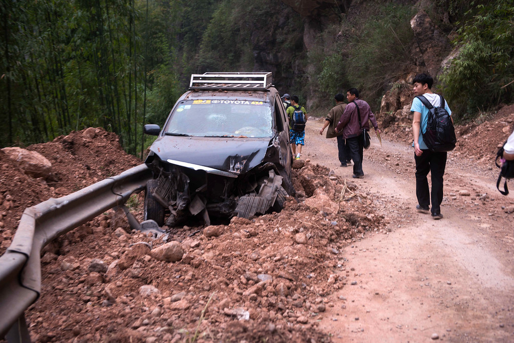 . This photo taken on April 21, 2013 shows a damaged car lying on the road in the disaster-hit area in Ya\'an, southwest China\'s Sichuan province.  STR/AFP/Getty Images