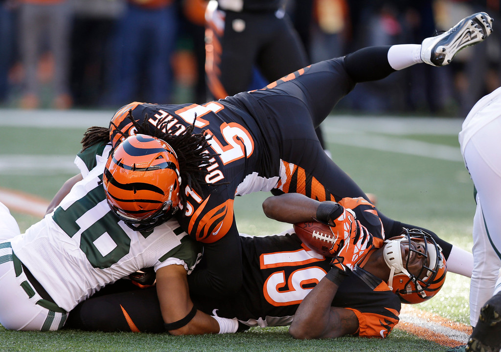 . Cincinnati Bengals kick returner Brandon Tate (19) is tackled by New York Jets\' Josh Cribbs (16) on the opening kickoff of an NFL football game, Sunday, Oct. 27, 2013, in Cincinnati. Bengals Jayson DiManche (51) blocks. (AP Photo/Al Behrman)