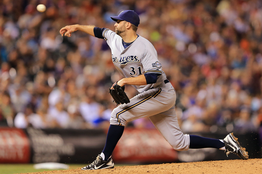 . DENVER, CO - JULY 26:  Pitcher Burke Badenhop #31 of the Milwaukee Brewers delivers against the Colorado Rockies at Coors Field on July 26, 2013 in Denver, Colorado.  (Photo by Doug Pensinger/Getty Images)