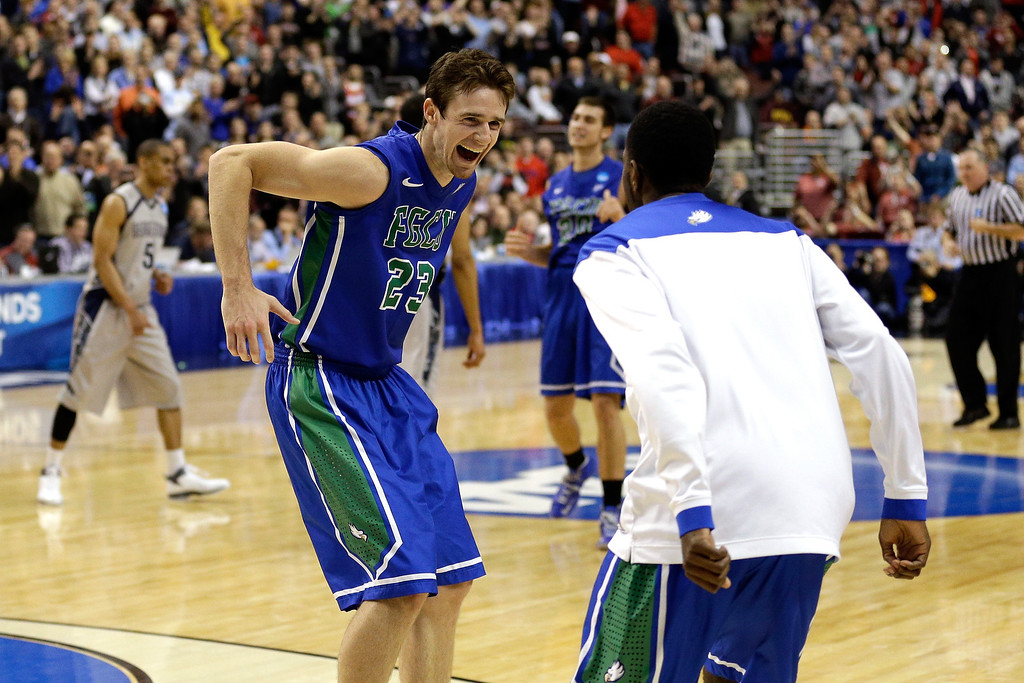 . PHILADELPHIA, PA - MARCH 22:  Eddie Murray #23 of the Florida Gulf Coast Eagles celebrates after they won 78-68 against the Georgetown Hoyas during the second round of the 2013 NCAA Men\'s Basketball Tournament at Wells Fargo Center on March 22, 2013 in Philadelphia, Pennsylvania.  (Photo by Rob Carr/Getty Images)