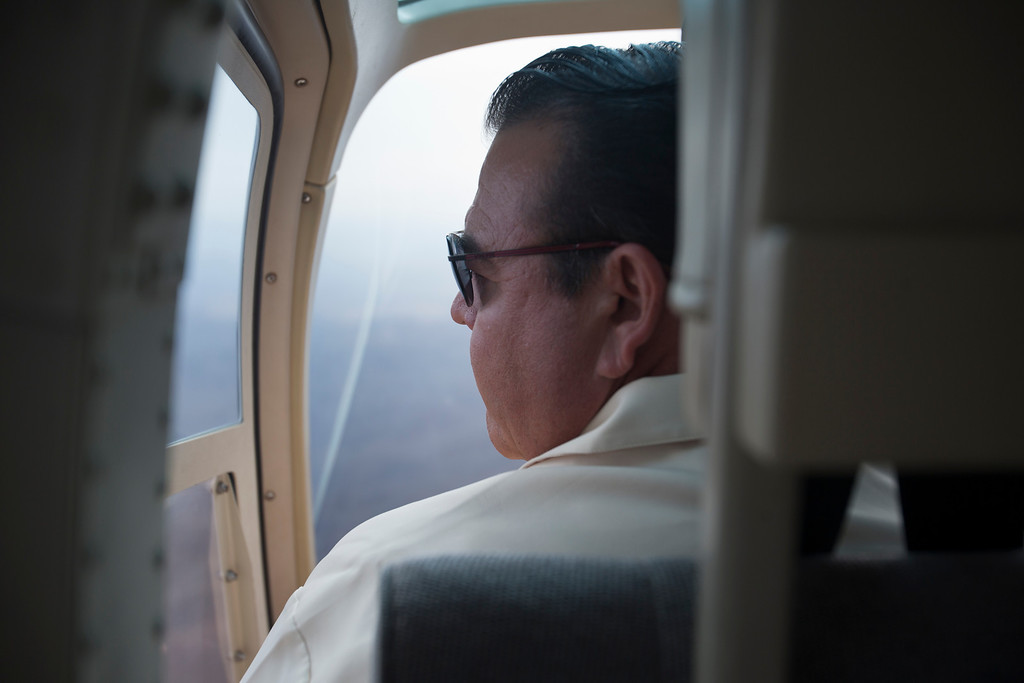 . In this June 11, 2013 photo, Sinaloa state secretary of Tourism Francisco Cordova looks out at the bridge called the Baluarte while flying in a helicopter near Concordia, Mexico where the new Durango-Mazatlan highway is being built.  ìIt will change the landscape of this part of the country,î said Tourism Secretary Francisco Cordova. ìIt\'s an opportunity to develop these areas and diversify the local economy.î (AP Photo/Dario Lopez-Mills)