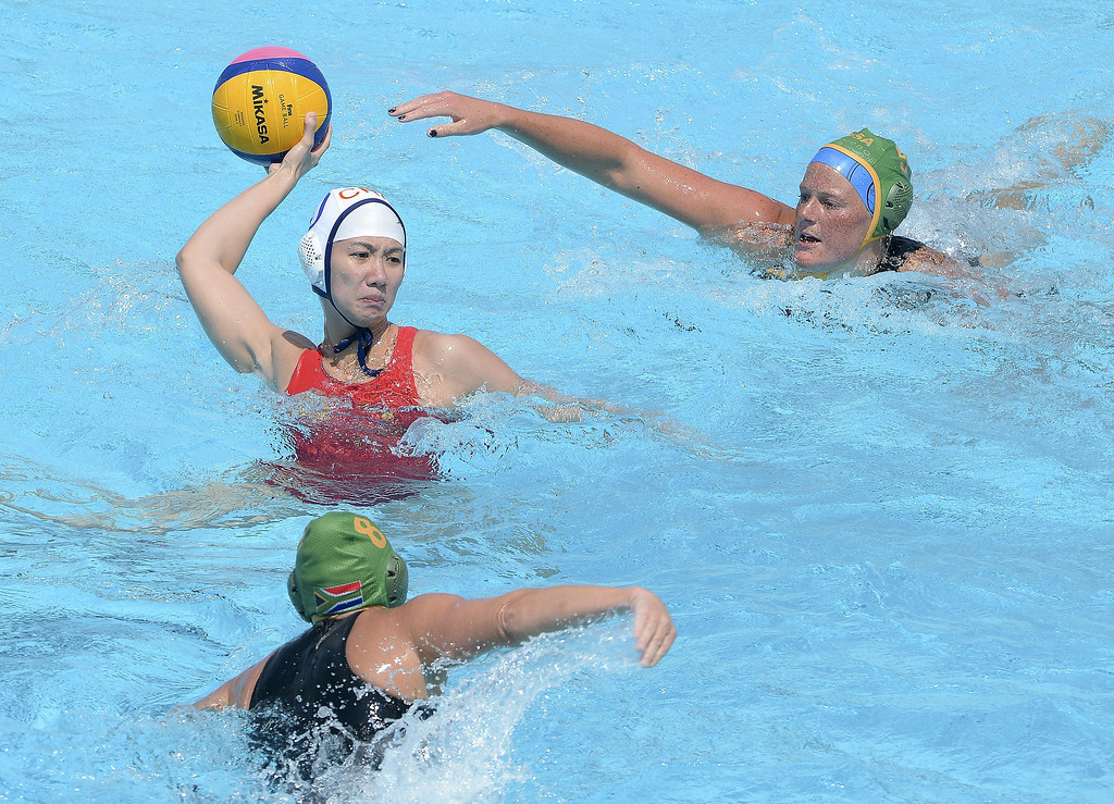 . China\'s Huanhuan Ma (L) is held back by South African Republic\'s Megan Schooling (R) and Lee-Anne Keet (down) during the preliminary rounds of the women\'s water polo at the FINA World Championships on July 21, 2013 in Bernat Picornell pools in Barcelona. China won 17-2.    JOSEP LAGO/AFP/Getty Images