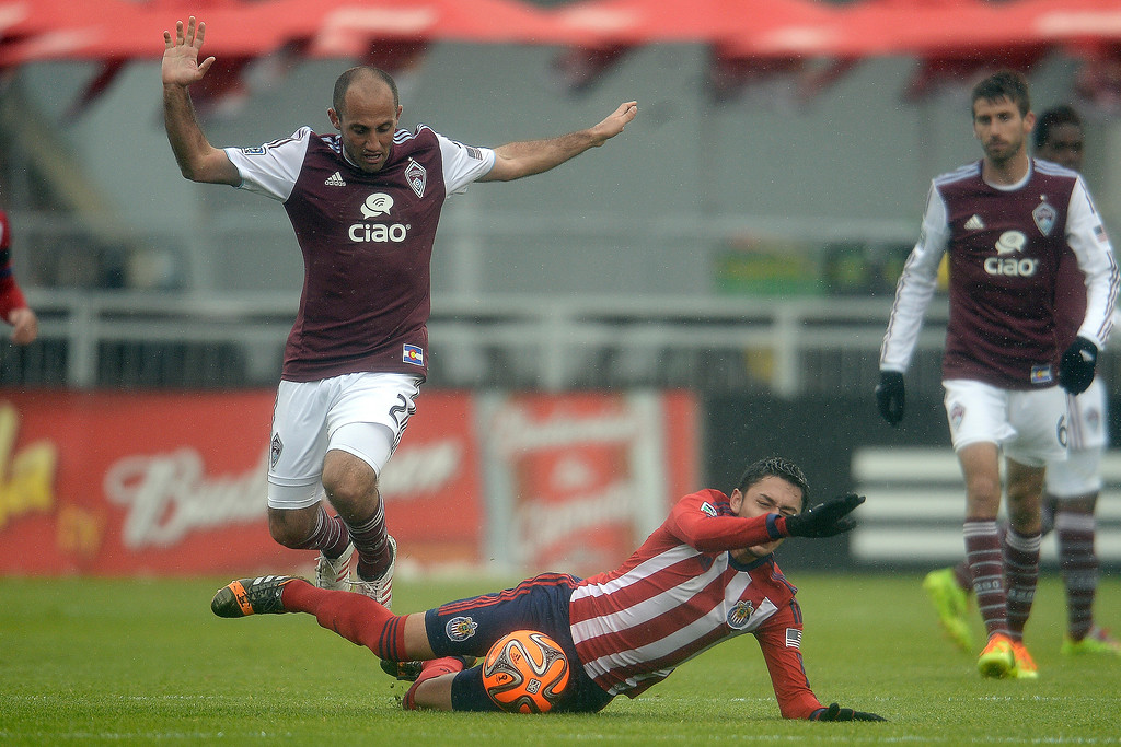 . Nick LaBrocca (2) of Colorado Rapids knocks Marco Delgado (12) of Chivas USA to the turf during the second half. Chivas USA defeated the Colorado Rapids 3-1 on Sunday, May 11, 2014. (Photo by AAron Ontiveroz/The Denver Post)