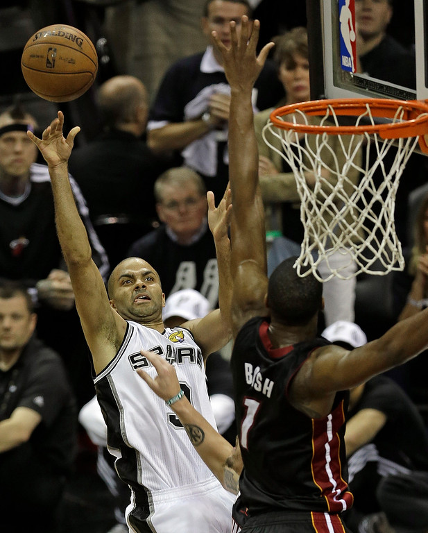 . San Antonio Spurs\' Tony Parker (9) shoots against Miami Heat\'s Chris Bosh (1) during the second half at Game 5 of the NBA Finals basketball series, Sunday, June 16, 2013, in San Antonio. The San Antonio Spurs won 114-104.(AP Photo/David J. Phillip)