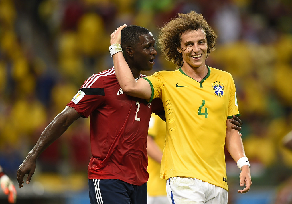 . Brazil\'s defender David Luiz (R) holds Colombia\'s defender Cristian Zapata\'s head during the quarter-final football match between Brazil and Colombia at the Castelao Stadium in Fortaleza during the 2014 FIFA World Cup on July 4, 2014. FABRICE COFFRINI/AFP/Getty Images