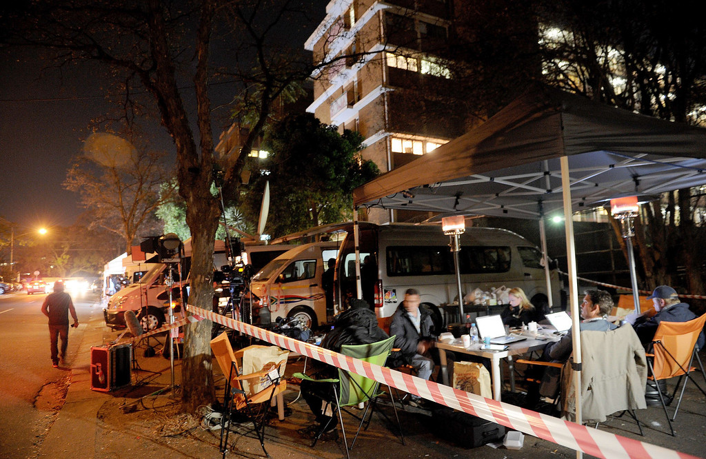 . This photo taken on the night of June 24, 2013 shows journalists waiting outside the Mediclinic Heart Hospital in Pretoria where former South African President Nelson Mandela is receiving treatment. Nelson Mandela\'s close family gathered on June 25 at his rural homestead to discuss the failing health of the South African anti-apartheid icon who was fighting for his life in hospital. Messages of support poured in from around the world for the Nobel Peace Prize winner, who spent 27 years behind bars for his struggle under white minority rule and went on to become South Africa\'s first black president. STEPHANE DE SAKUTIN/AFP/Getty Images