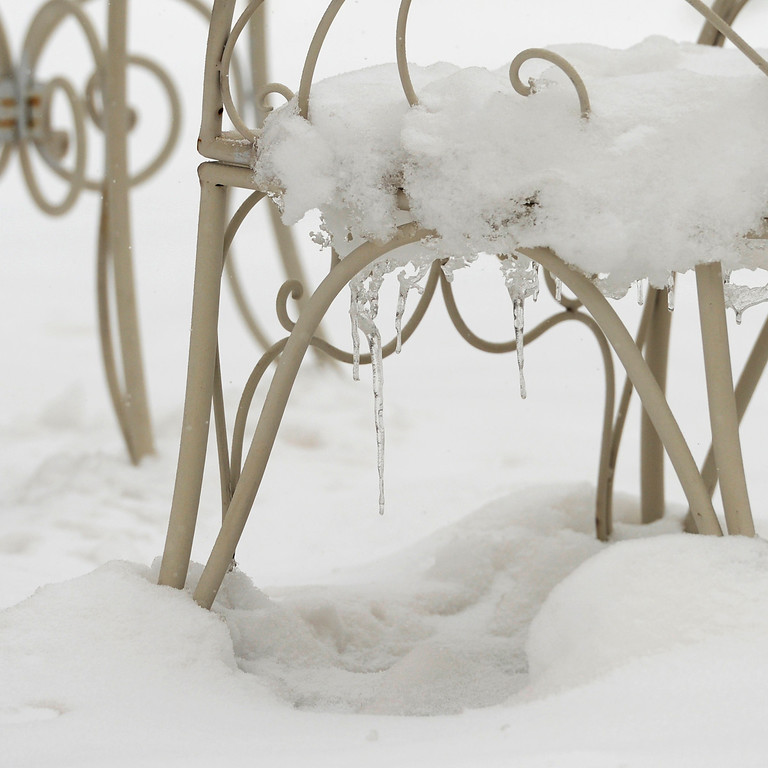 . ARVADA, CO-April 17, 2013: Outdoor patio furniture is covered in new snow in Arvada, April 17, 2013. Snow continues to fall as a spring storm hits much of Colorado. (Photo By RJ Sangosti/The Denver Post)