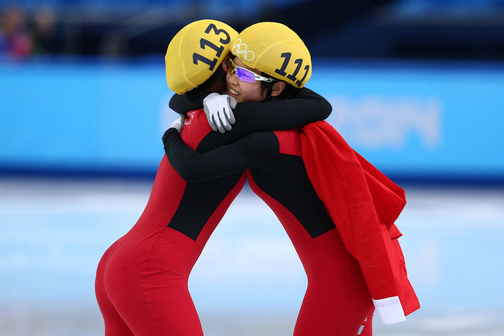 . SOCHI, RUSSIA - FEBRUARY 15:  Yang Zhou (L) of China is congratulated by Jianrou Li of China after winning the gold medal during the Ladies\' 1500 m Final Short Track Speed Skating on day 8 of the Sochi 2014 Winter Olympics at the Iceberg Skating Palace on February 15, 2014 in Sochi, Russia.  (Photo by Paul Gilham/Getty Images)