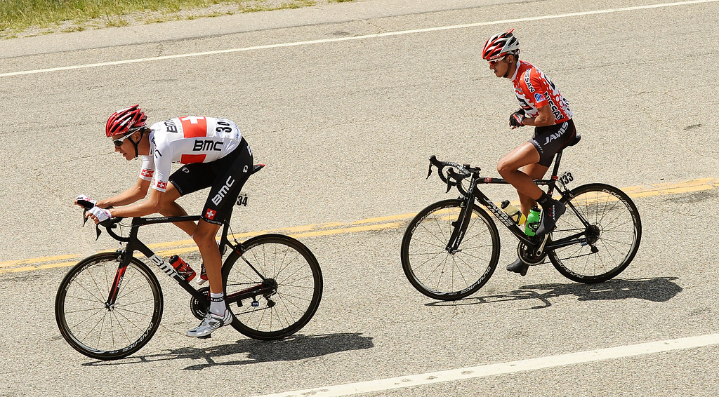 . Michael Schar of BMC Racing Team, left, and Matt Cooke of Jamis-Hagens Berman p/b Sutter Home ride toward Fairplay, while en route to Breckenridge from Aspen. (Photo By Hyoung Chang/The Denver Post)