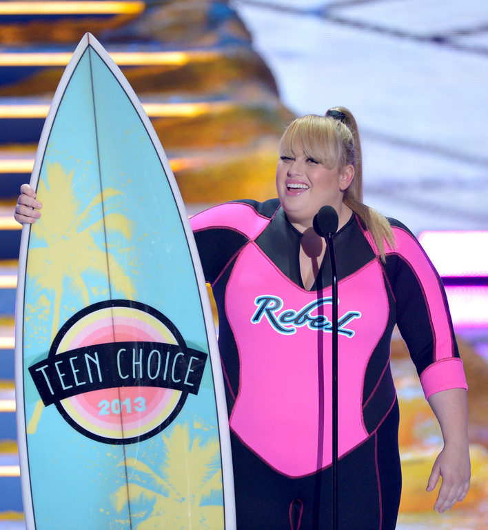 ". Rebel Wilson accepts the award for choice movie actress: comedy for ""Pitch Perfect\"" at the Teen Choice Awards at the Gibson Amphitheater on Sunday, Aug. 11, 2013, in Los Angeles. (Photo by John Shearer/Invision/AP)"