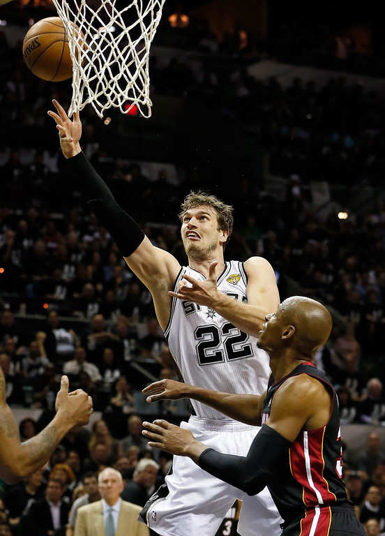. Tiago Splitter #22 of the San Antonio Spurs goes up for a shot over Ray Allen #34 of the Miami Heat in the first half during Game Five of the 2013 NBA Finals at the AT&T Center on June 16, 2013 in San Antonio, Texas. (Photo by Kevin C. Cox/Getty Images)