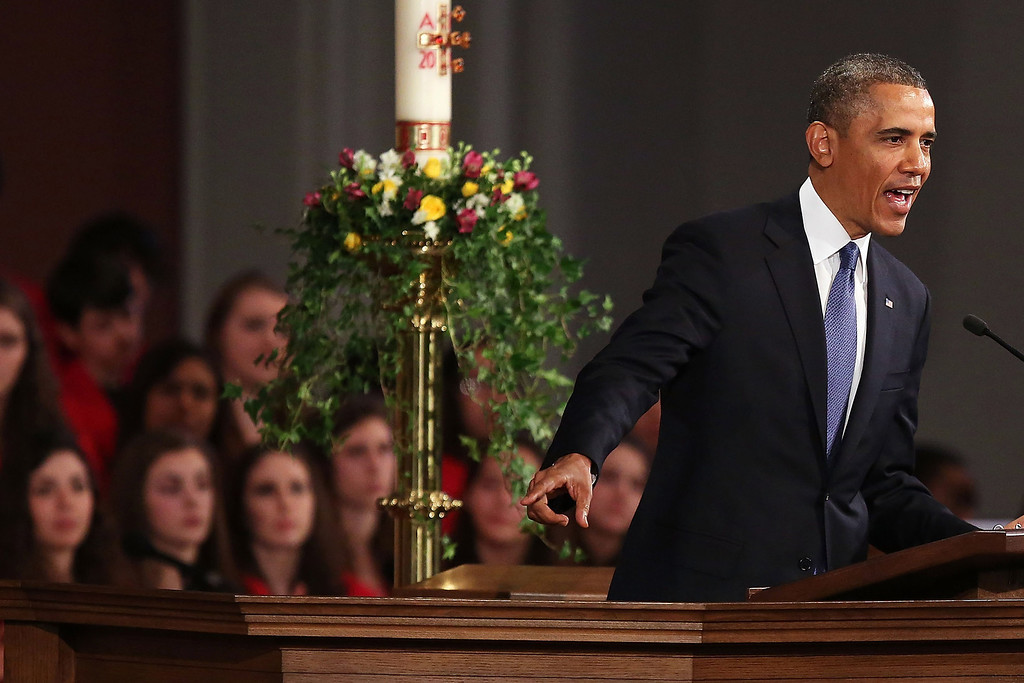 ". President Barack Obama speaks at an interfaith prayer service for victims of the Boston Marathon attack titled ""Healing Our City,\"" at the Cathedral of the Holy Cross on April 18, 2013 in Boston, Massachusetts. (Photo by Spencer Platt/Getty Images)"