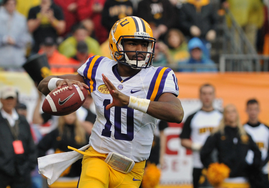 . Quarterback Anthony Jennings #10 of the LSU Tigers sets to pass in the second quarter against the Iowa Hawkeyes January 1, 2014  in the Outback Bowl at Raymond James Stadium in Tampa, Florida.  (Photo by Al Messerschmidt/Getty Images)