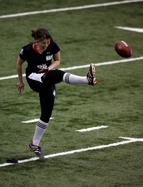 . Lauren Silberman boots the ball during kicker tryouts at the NFL football regional combine workout Sunday, March 3, 2013, in Florham Park, N.J. (AP Photo/Mel Evans)