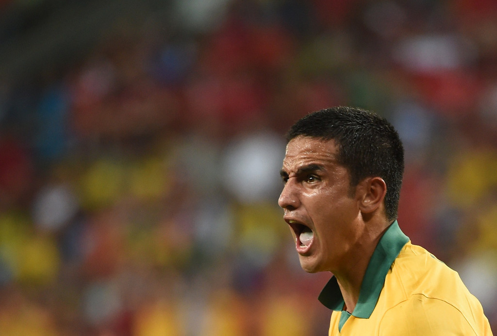 . Australia\'s forward Tim Cahill reacts during a Group B football match between Chile and Australia at the Pantanal Arena in Cuiaba during the 2014 FIFA World Cup on June 13, 2014.     AFP PHOTO / WILLIAM WEST