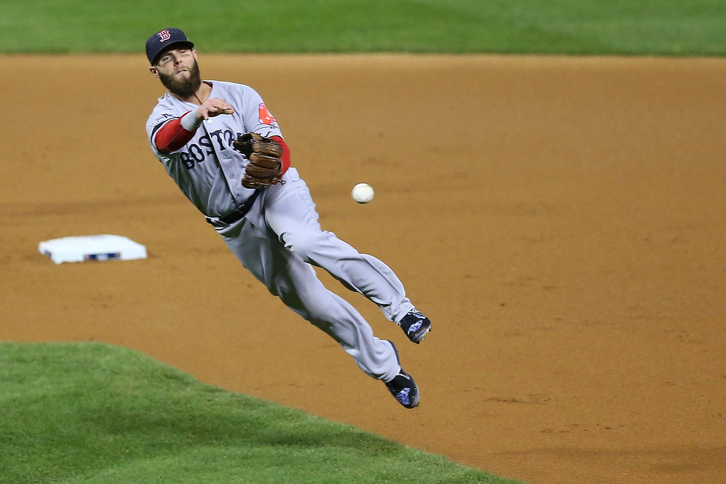 . Dustin Pedroia #15 of the Boston Red Sox fields a ball hit by Shane Robinson #43 of the St. Louis Cardinals  for an out in the first inning of Game Five of the 2013 World Series at Busch Stadium on October 28, 2013 in St Louis, Missouri.  (Photo by Ronald Martinez/Getty Images)
