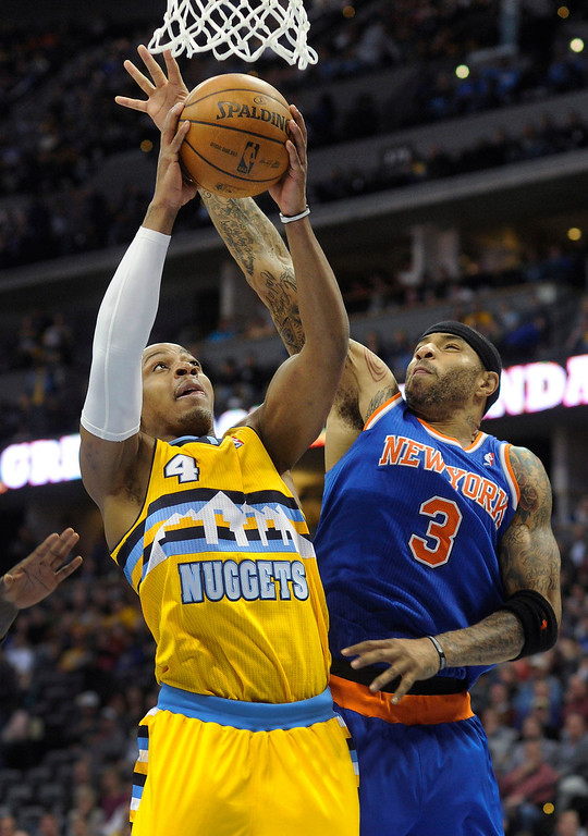 . Kenyon Martin (3) tried to block a shot by Denver guard Randy Foye (4) in the second half.    Photo By Karl Gehring/The Denver Post