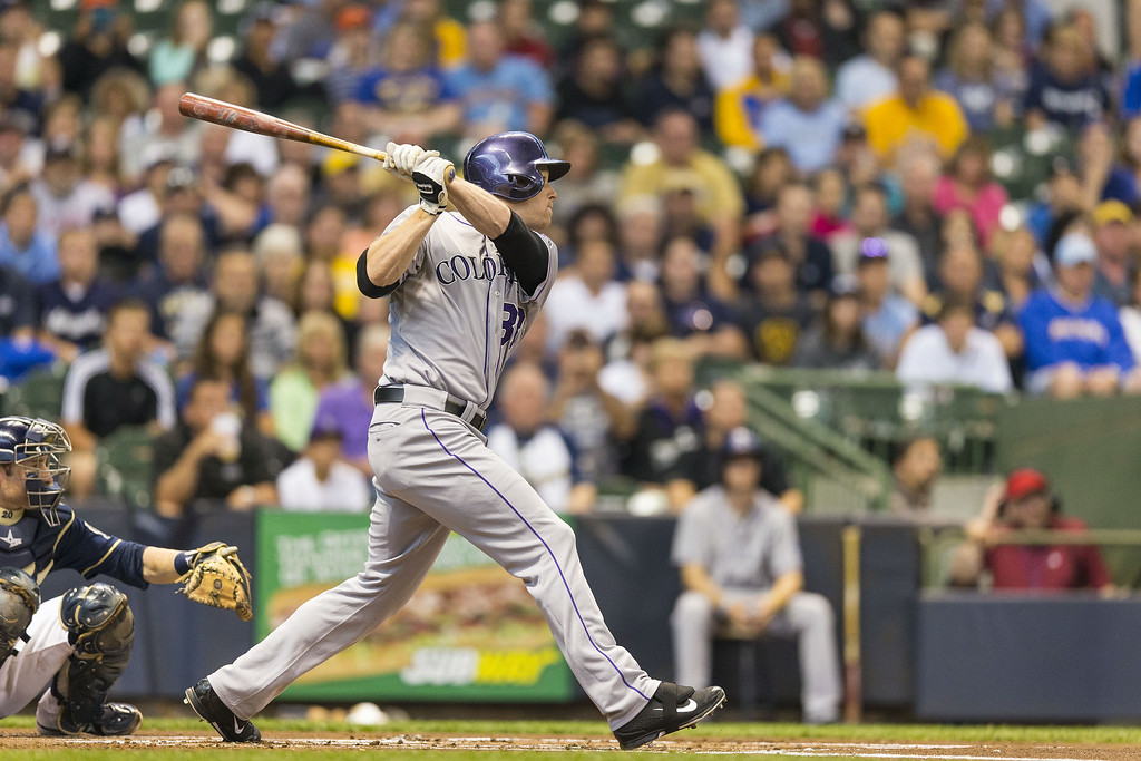 . Justin Morneau #33 of the Colorado Rockies hits a double off of Wily Peralta (not pictured) of the Milwaukee Brewers at Miller Park on June 26, 2014 in Milwaukee, Wisconsin.  (Photo by Tom Lynn/Getty Images)