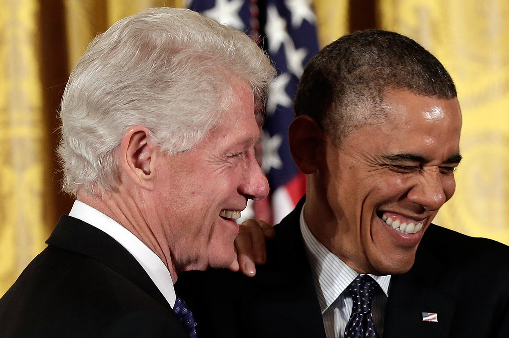 . U.S. President Barack Obama (R) jokes with former U.S. President Bill Clinton before awarding him the Presidential Medal of Freedom in the East Room at the White House on November 20, 2013 in Washington, DC.  (Photo by Win McNamee/Getty Images)