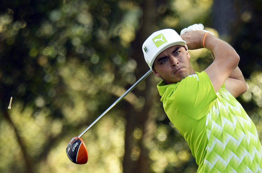 . Rickie Fowler of the US hits a tee shot during the first round of the 78th Masters Golf Tournament at Augusta National Golf Club on April 10, 2014 in Augusta, Georgia. The 78th Masters got underway early April 10, with living legends Arnold Palmer, Jack Nicklaus and Gary Player hitting the first balls as honorary starters. AFP PHOTO/Timothy A. Clary/AFP/Getty Images