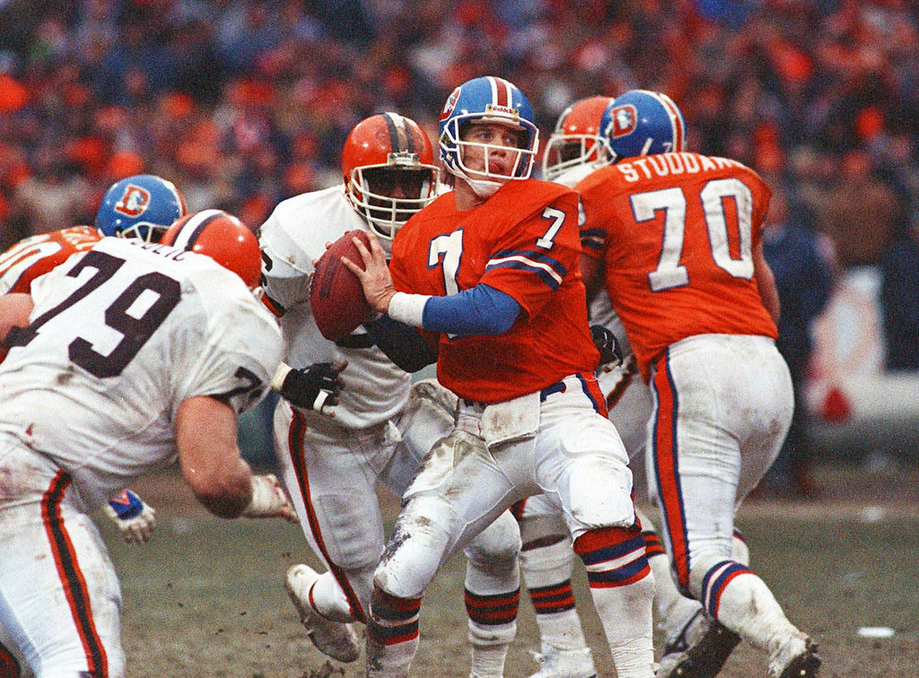 . In this Jan. 12, 1987 file photo Denver Broncos quarterback John Elway prepares to send the ball downfield en route to a 23-20 overtime victory in the AFC Championship game against the Cleveland Browns, in Cleveland. Elway\'s heroics became one of many events cited by Cleveland sports fans as evidence of a curse on its teams. (AP Photo)