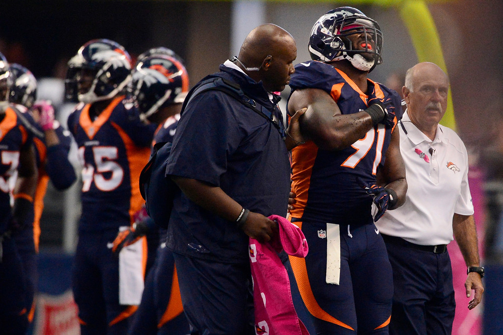 . ARLINGTON, TX - OCTOBER 6: Robert Ayers (91) of the Denver Broncos holds his shoulder after being injured against the Dallas Cowboys during the first half of action at AT&T Stadium. The Denver Broncos visit the Dallas Cowboys. (Photo by AAron Ontiveroz/The Denver Post)