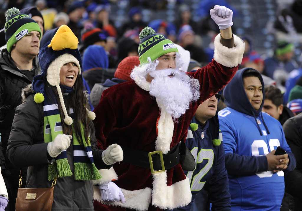 . Seattle Seahawks supporters cheer at the end of an NFL football game against the New York Giants, Sunday, Dec. 15, 2013, in East Rutherford, N.J. The Seahawks won 23-0. (AP Photo/Bill Kostroun)