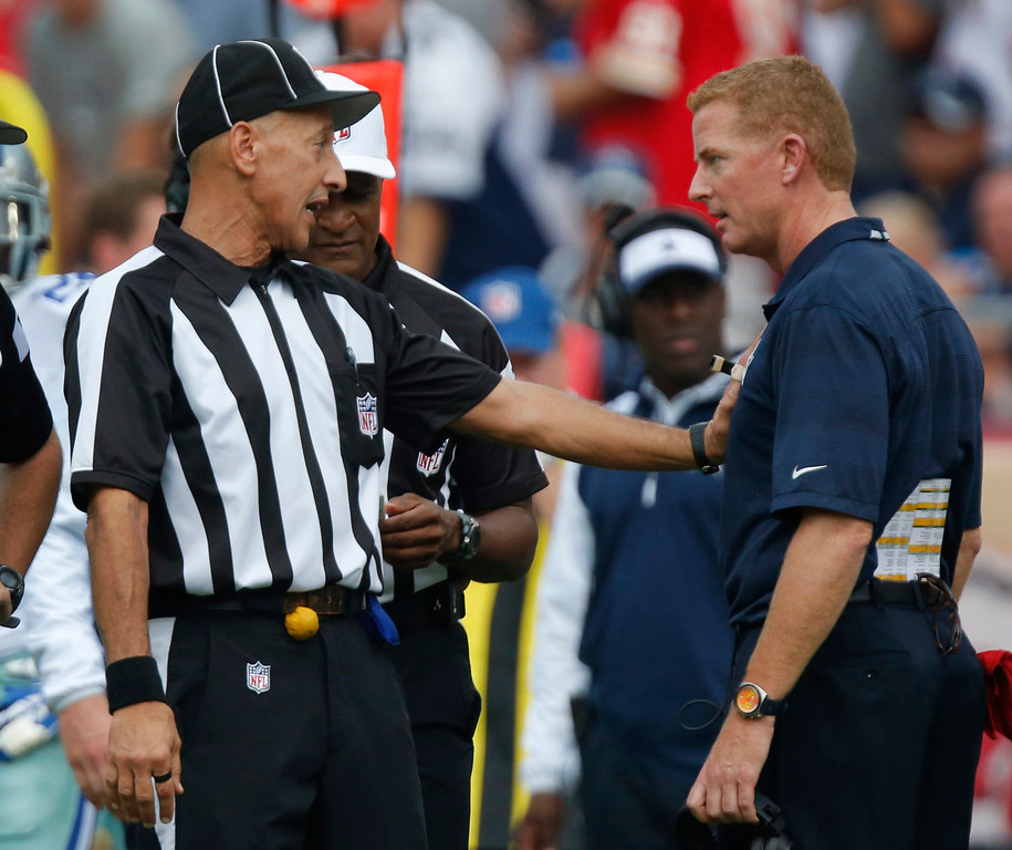 . Dallas Cowboys coach Jason Garrett, right, talks with back judge Tony Steratore during the first half of an NFL football game against the Kansas City Chiefs at Arrowhead Stadium in Kansas City, Mo., Sunday, Sept. 15, 2013. (AP Photo/Ed Zurga)