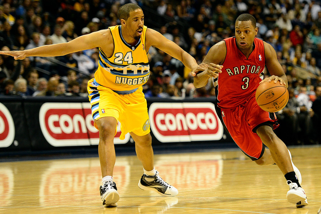 . Toronto Raptors point guard Kyle Lowry (3) drives on Denver Nuggets point guard Andre Miller (24) during the second half of the Nuggets\' 113-110 win at the Pepsi Center on Monday, December 3, 2012. AAron Ontiveroz, The Denver Post