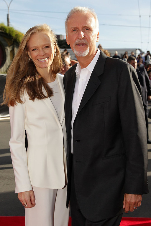 """. Film director James Cameron and wife Suzy Amis arrive at the \""""The Hobbit: An Unexpected Journey\"""" World Premiere at Embassy Theatre on November 28, 2012 in Wellington, New Zealand.  (Photo by Hagen Hopkins/Getty Images)"""