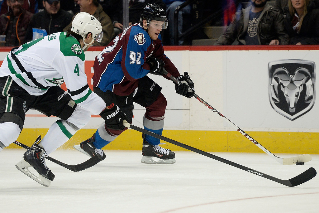. DENVER, CO - DECEMBER 16: Colorado Avalanche left wing Gabriel Landeskog (92) controls the puck as Dallas Stars defenseman Brenden Dillon (4) defends during the third period of the Avs\' 6-2 win. The Colorado Avalanche hosted the Dallas stars at the Pepsi Center. (Photo by AAron Ontiveroz/The Denver Post)