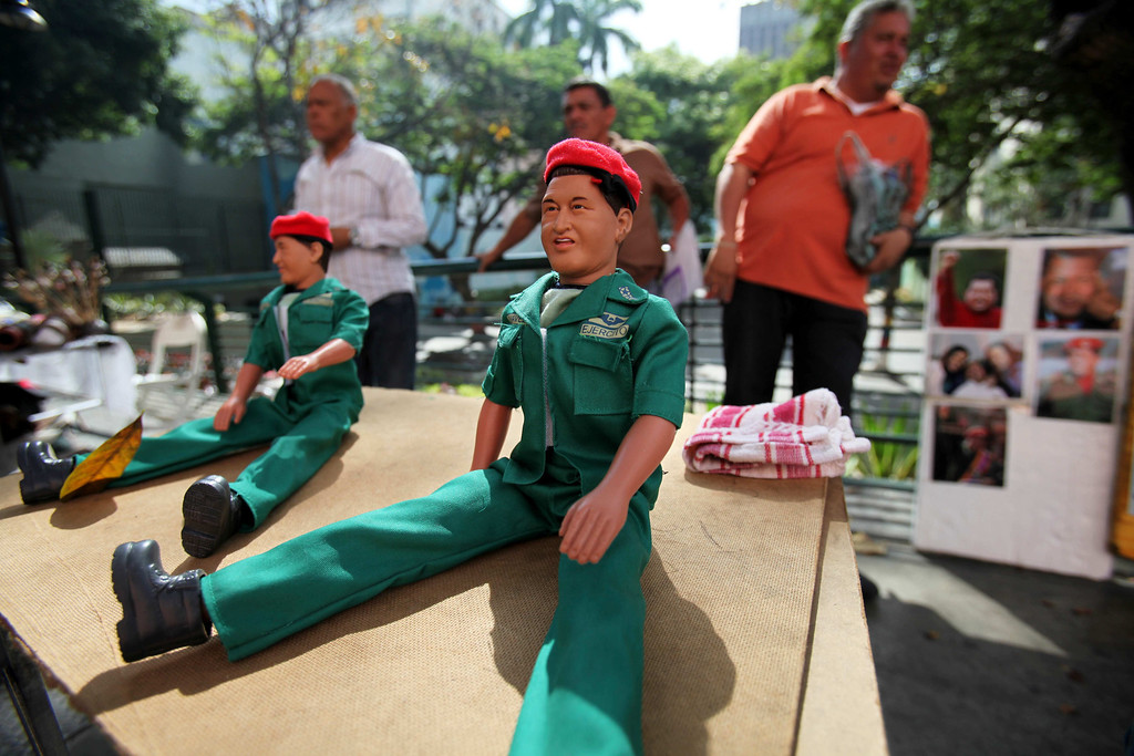 . A doll of Venezuela\'s late President Hugo Chavez sits for sale on a vendor\'s table in Caracas, Venezuela, Monday, March 11, 2013. At Caracas\'s choked Bolivar Plaza, a favorite hangout for the late president\'s supporters, shoppers can find virtually anything Chavez-related the mind can dream up. (AP Photo/Fernando Llano)