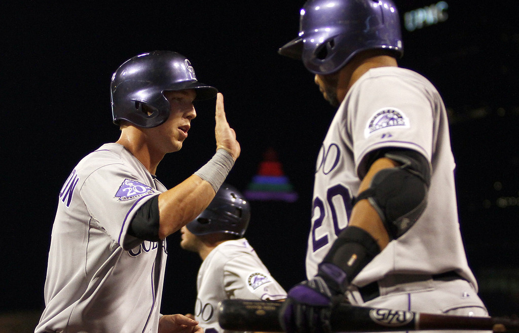 . PITTSBURGH, PA - AUGUST 03:  Corey Dickerson #6 of the Colorado Rockies celebrates after scoring on an RBI single in the eighth inning against the Pittsburgh Pirates during the game on August 3, 2013 at PNC Park in Pittsburgh, Pennsylvania.  (Photo by Justin K. Aller/Getty Images)