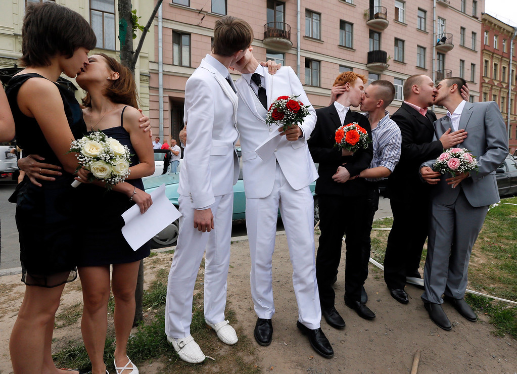 . In this photo made Friday, June 28, 2013,  gay and lesbian couples pose outside a registry office after they tried to get married in St.Petersburg, Russia. On Friday, three gay and two lesbian couples attempted to marry at a registry office in St. Petersburg, but were refused by authorities. Russiaís parliament passed a law banning ìgay propagandaî earlier this month. St. Petersburg was one of several cities to pass similar laws at local level before that. (AP Photo/Dmitry Lovetsky)